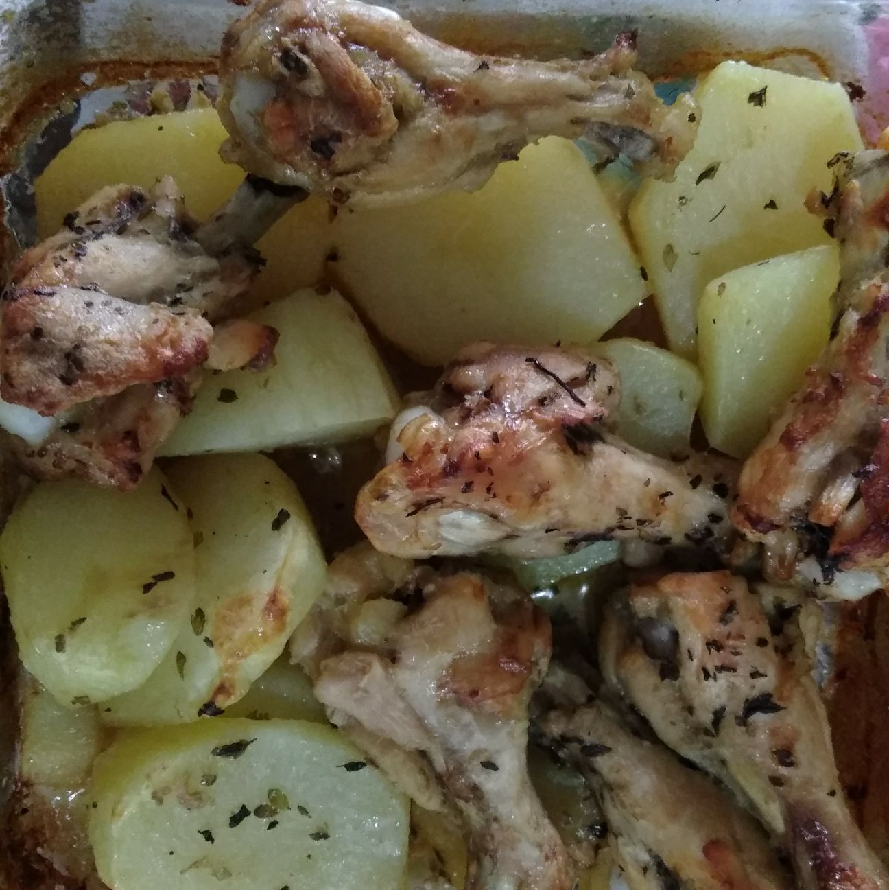 Coxa de galinha com batatas no forno